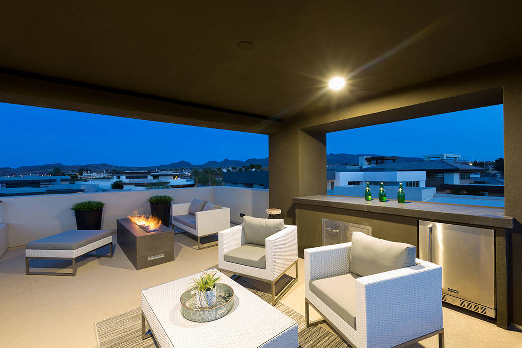 The rooftop deck has a sitting area with a fire feature. (The Red Luxury Real Estate)