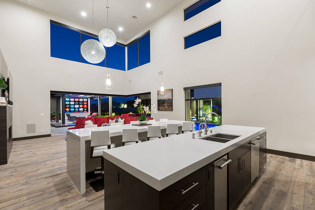 The kitchen connects to the backyard entertainment area. (The Red Luxury Real Estate)