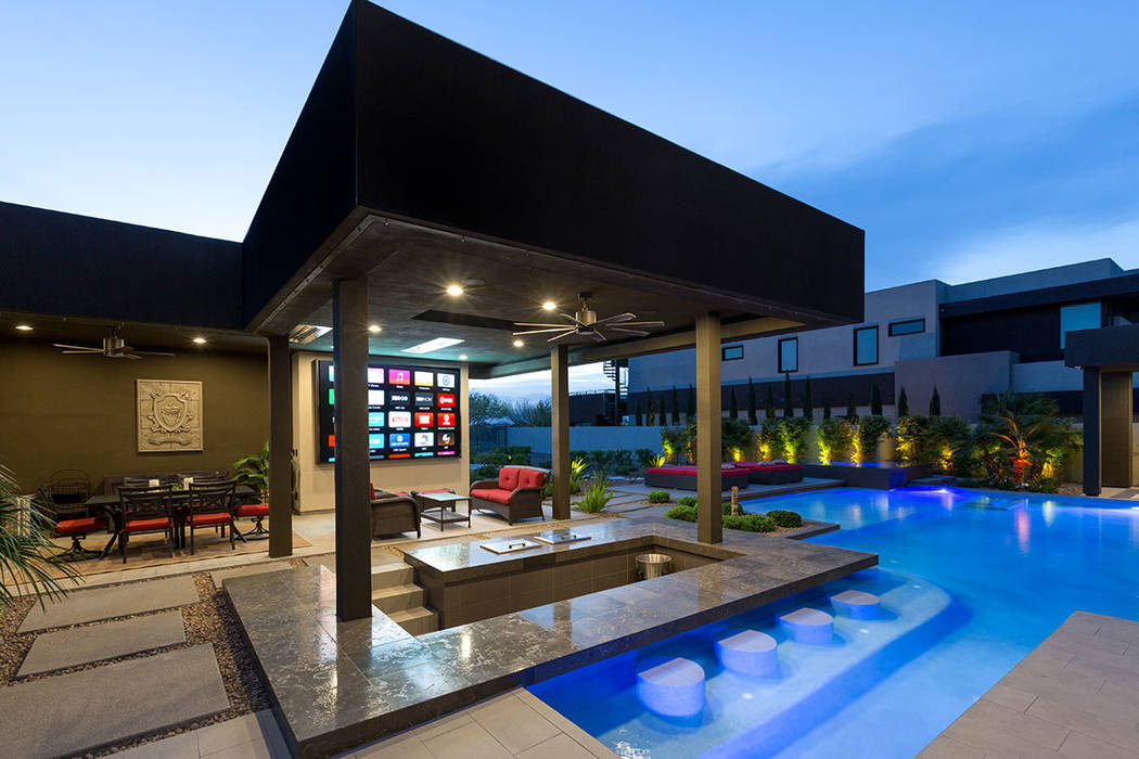 The pool has a swim-up bar for guests who wish to watch movies or sports on the 132-inch, custom HD/LED digital display TV. (The Red Luxury Real Estate)
