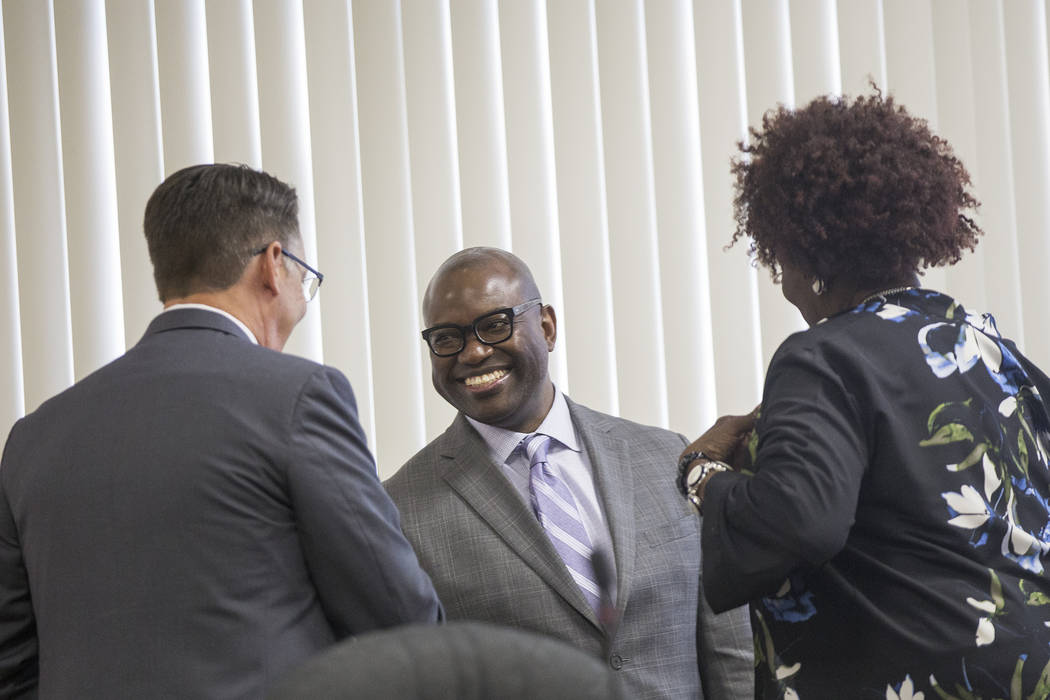 Chad Williams greets Commissioner Scott Black, left, and Chairperson Dora LaGrande, right, before a Southern Nevada Regional Housing Authority board meeting at the commission chambers in Las Vegas ...