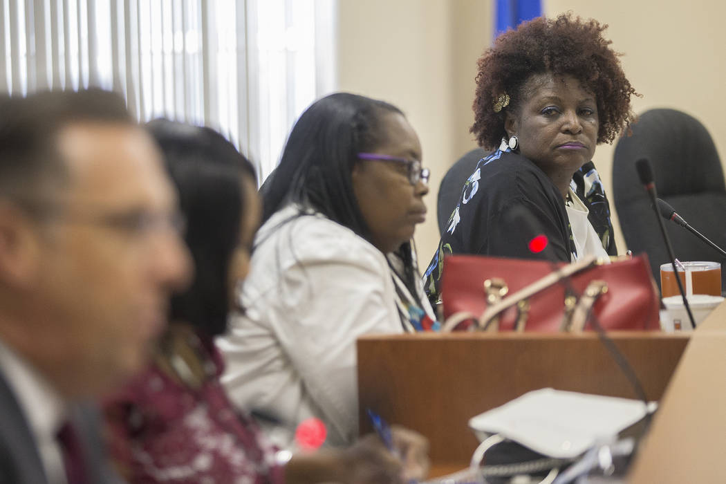 Chairperson Dora LaGrande listens as Commissioner Scott Black talks about his approval of the new Executive Director Chad Williams at the Southern Nevada Regional Housing Authority board meeting a ...