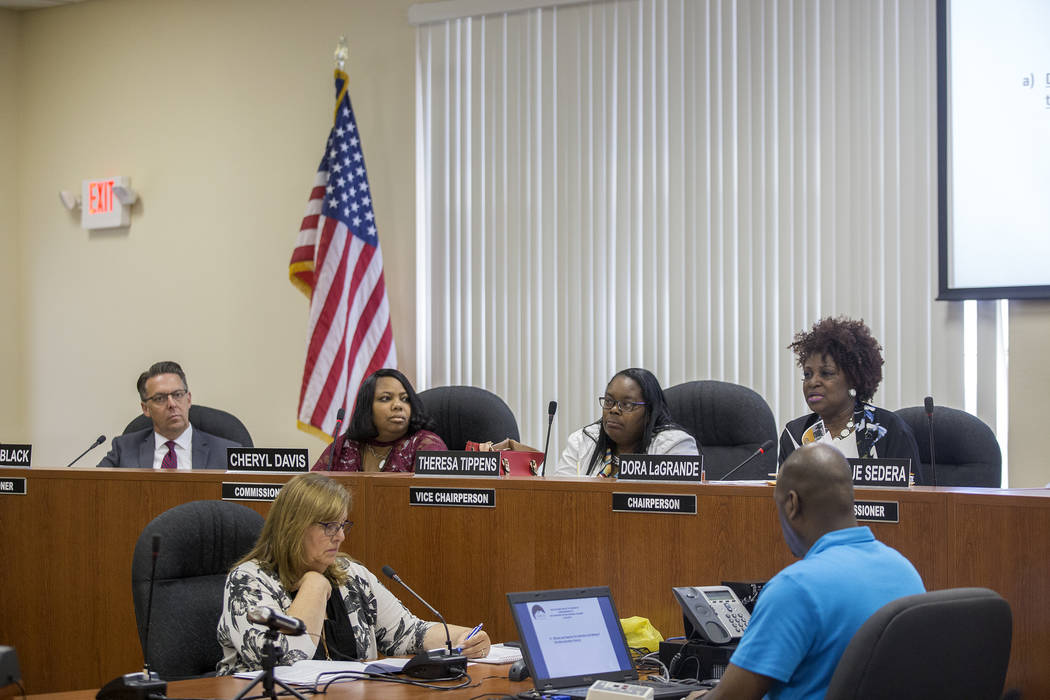 Chairperson Dora LaGrande speaks as Commissioner Scott Black, from left, listens alongside Commissioner Cheryl Davis and Commissioner Theresa Tippens at the Southern Nevada Regional Housing Author ...