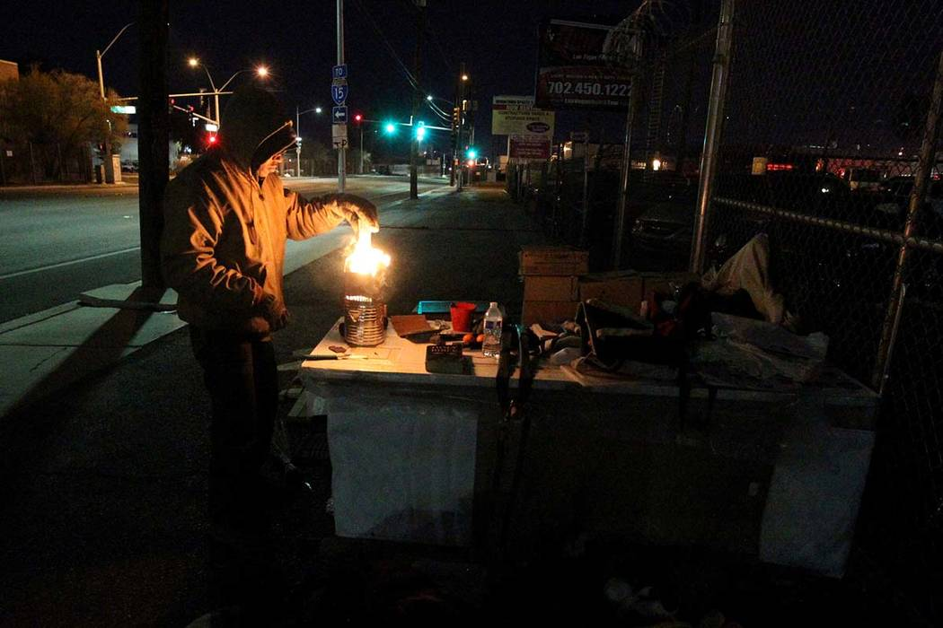 Stephen Duncan, 48, sets up camp on Bonanza Road near D Street in Las Vegas Wednesday, Feb. 21, 2018. Duncan, who said that he is currently homeless, hopes to get permanent housing where he can ke ...