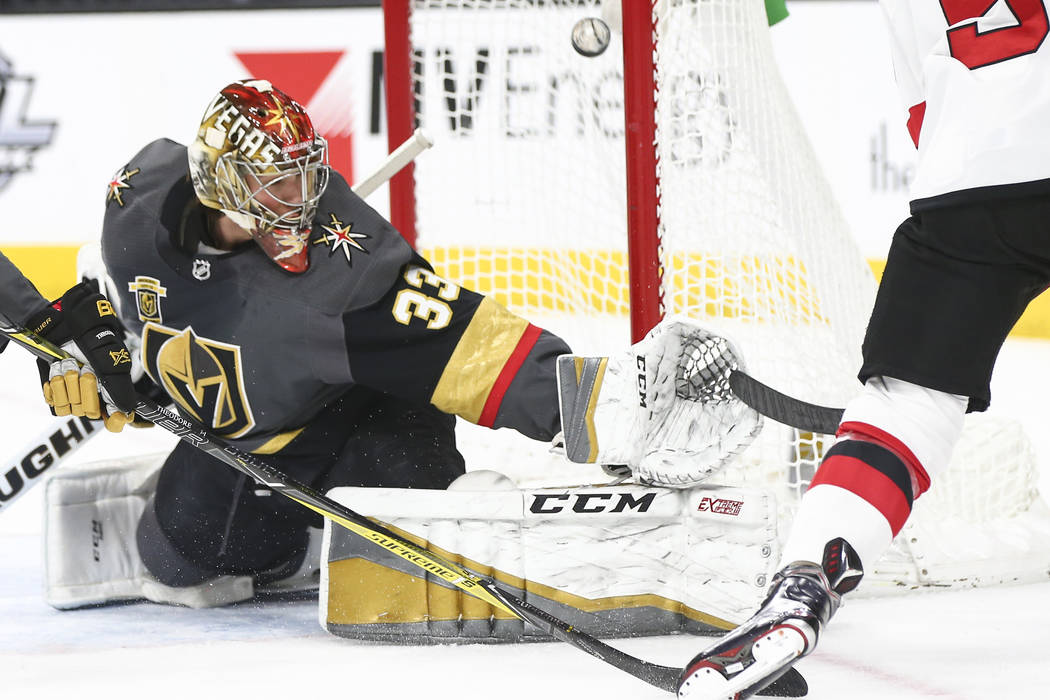 Golden Knights goaltender Maxime Lagace (33) blocks a shot from New Jersey Devils left wing Taylor Hall (9) during the second period of an NHL hockey game at T-Mobile Arena in Las Vegas on Wednesd ...