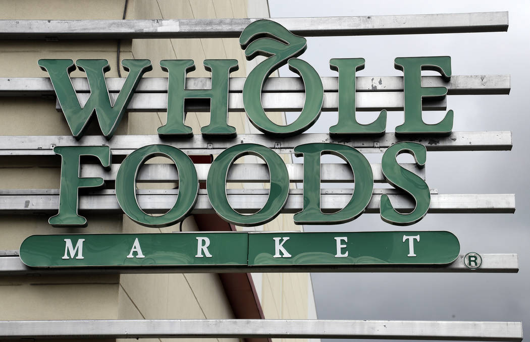 FILE - In this Monday, Aug. 28, 2017, file photo, a sign at a Whole Foods Market greets shoppers in Tampa, Fla. Amazon is bringing its Prime membership to Whole Foods, giving members special disco ...
