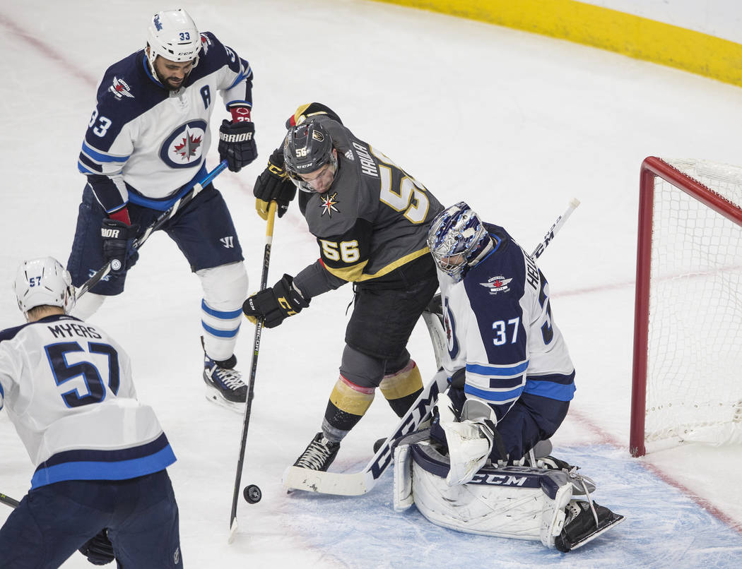 Golden Knights left wing Erik Haula (56) shoots on Jets goaltender Connor Hellebuyckus (37) in the second period during game three of Las Vegas' NHL Western Conference Finals matchup with Winnipeg ...
