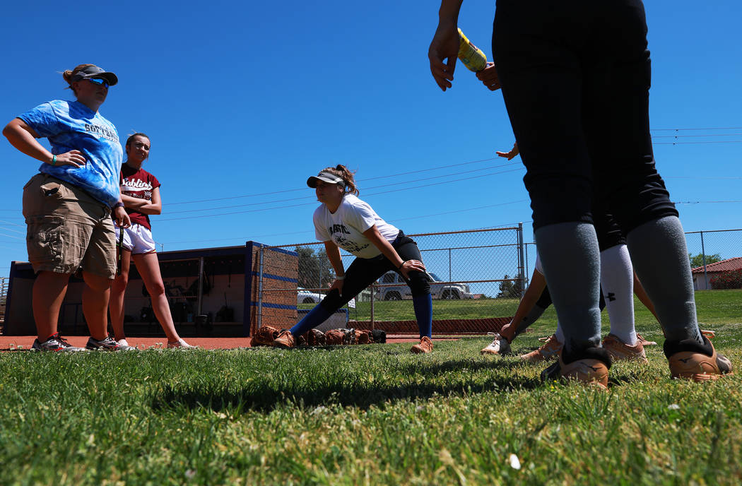 Basic's Angela Santillanes, center, stretches during softball practice at Basic High School in Henderson, Nevada on Tuesday, May 15, 2018. Andrea Cornejo Las Vegas Review-Journal @dreacornejo