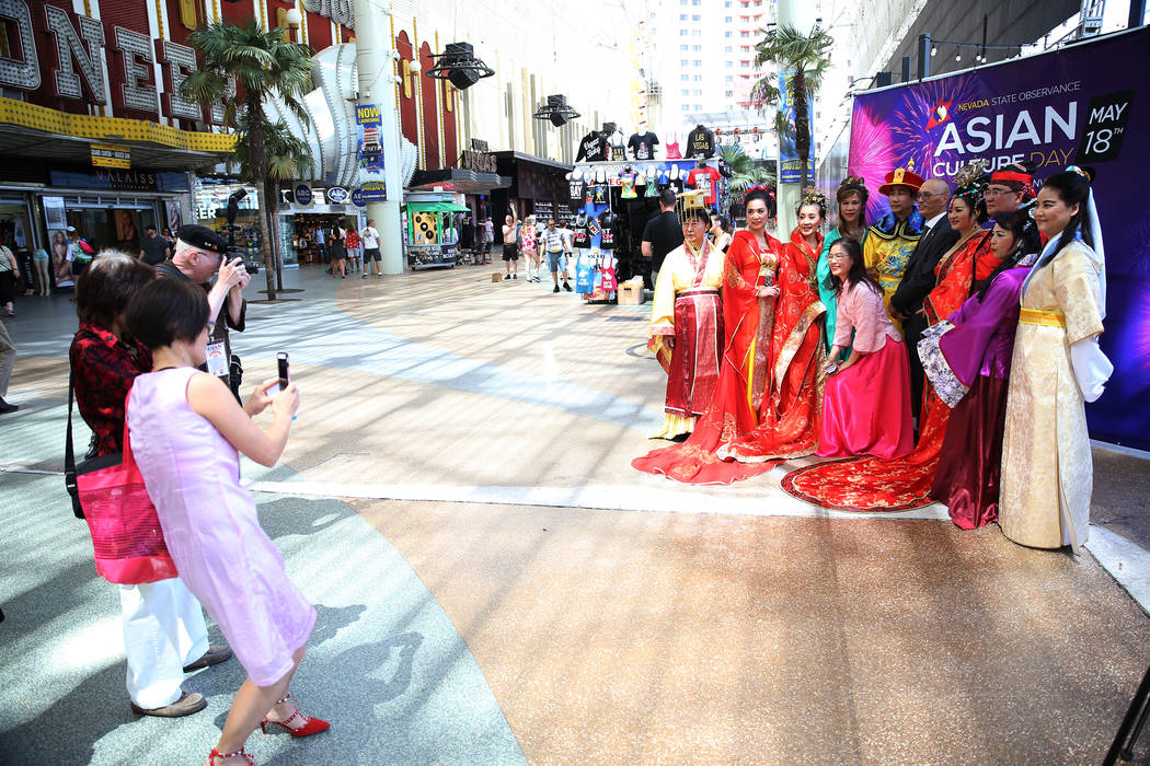 People photograph performers during the Asian Culture Day Celebration at Fremont Street Experience in Las Vegas, Wednesday, May 16, 2018. Erik Verduzco Las Vegas Review-Journal @Erik_Verduzco