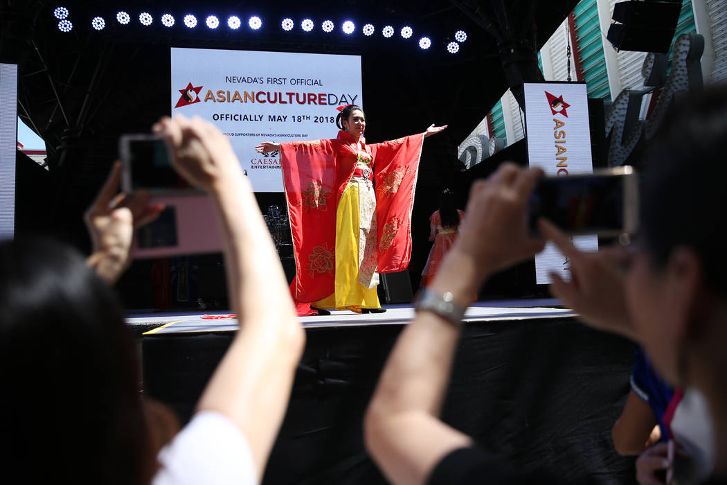 Lina Zhou performs during the Asian Culture Day Celebration at Fremont Street Experience in Las Vegas, Wednesday, May 16, 2018. Erik Verduzco Las Vegas Review-Journal @Erik_Verduzco