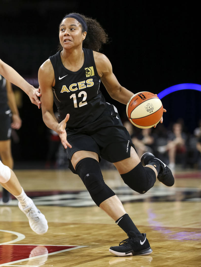 Las Vegas Aces forward Nia Coffey (12) dribbles the ball against the Chinese national team during a preseason basketball game at Mandalay Bay Events Center in Las Vegas on Sunday, May 6, 2018. Ric ...