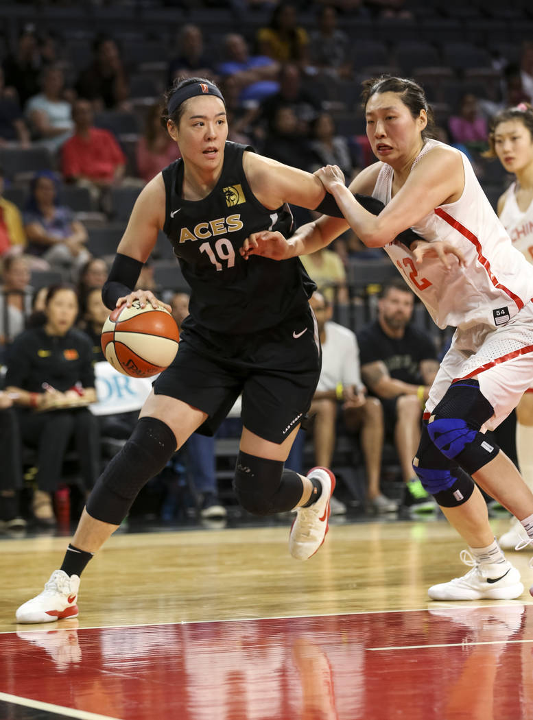 Las Vegas Aces center Ji-Su Park (19) drives the ball against China's Jiacen Liu (12) during a preseason basketball game at Mandalay Bay Events Center in Las Vegas on Sunday, May 6, 2018. Richard ...
