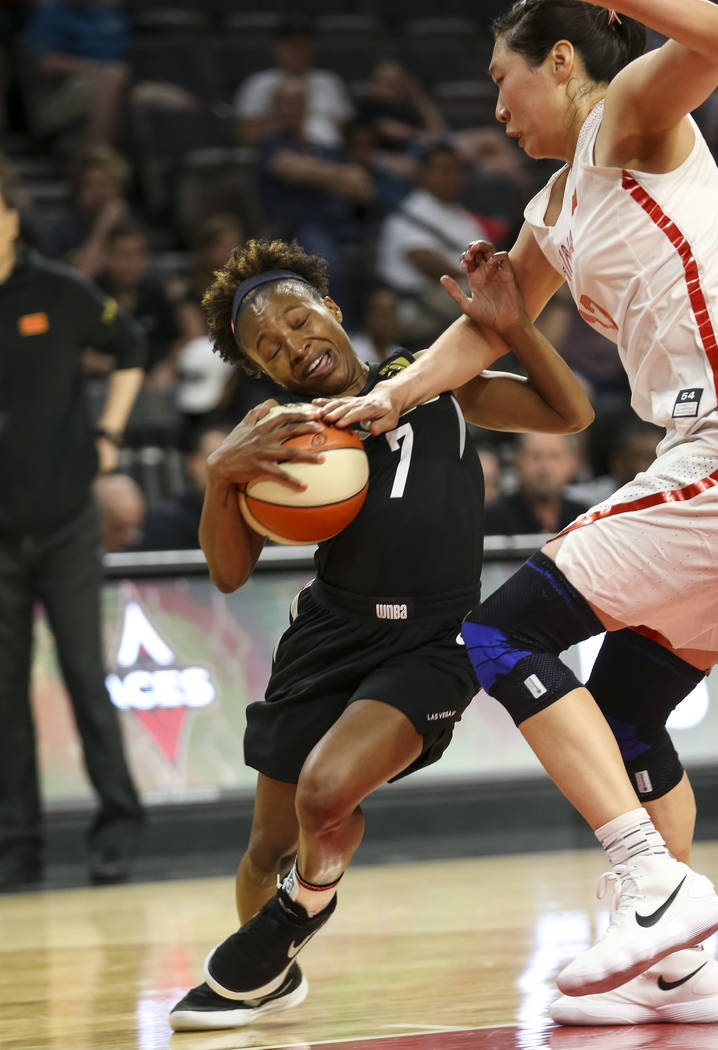 Las Vegas Aces guard Morgan William (7) gets fouled by China's Jiacen Liu (12) during a preseason basketball game at Mandalay Bay Events Center in Las Vegas on Sunday, May 6, 2018. Richard Brian L ...