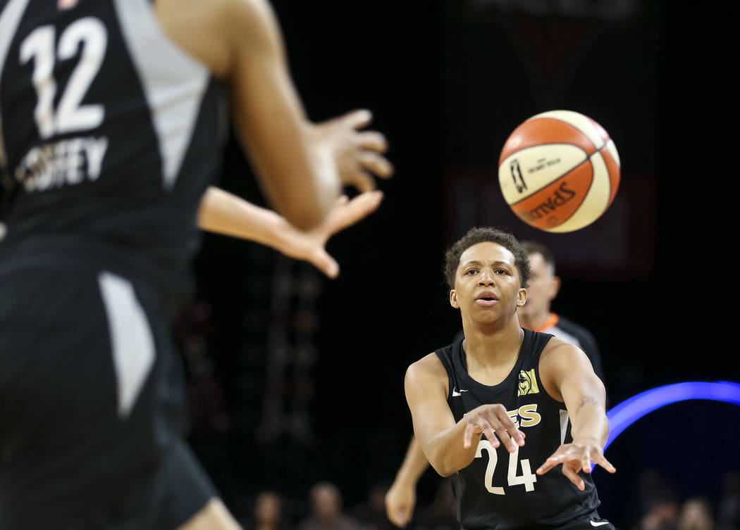 Las Vegas Aces guard Kahlia Lawrence (24) passes to forward Nia Coffey (12) during a preseason basketball game against the Chinese national team at Mandalay Bay Events Center in Las Vegas on Sunda ...