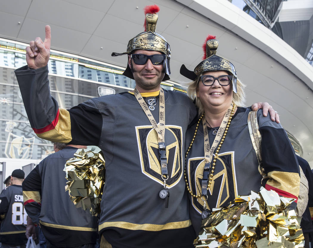 Golden Knights fans Chris Lekic, left, and Jennifer Shockey outside T-Mobile Arena before the start of game three of Las Vegas' NHL Western Conference Finals matchup with the Winnipeg Jets on Wedn ...
