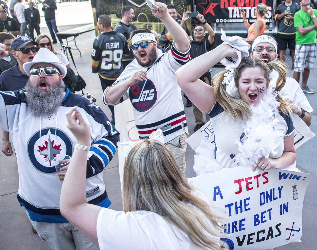 Winnipeg Jets fans cheer for their team outside T-Mobile Arena before the start of game three of their NHL Western Conference Finals matchup with the Golden Knights on Wednesday, May 16, 2018, at ...