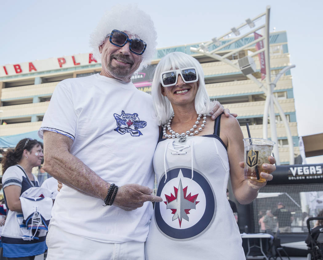 Winnipeg Jets fans Rob Zolezzi, left, and Pam Herda outside T-Mobile Arena before the start of game three of their NHL Western Conference Finals matchup with the Golden Knights on Wednesday, May 1 ...