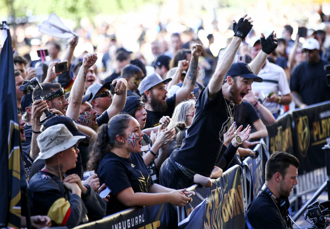 Golden Knights fans cheer at Toshiba Plaza ahead of Game 3 of the NHL Western Conference finals hockey playoff series at T-Mobile Arena in Las Vegas on Wednesday, May 16, 2018. Chase Stevens Las V ...