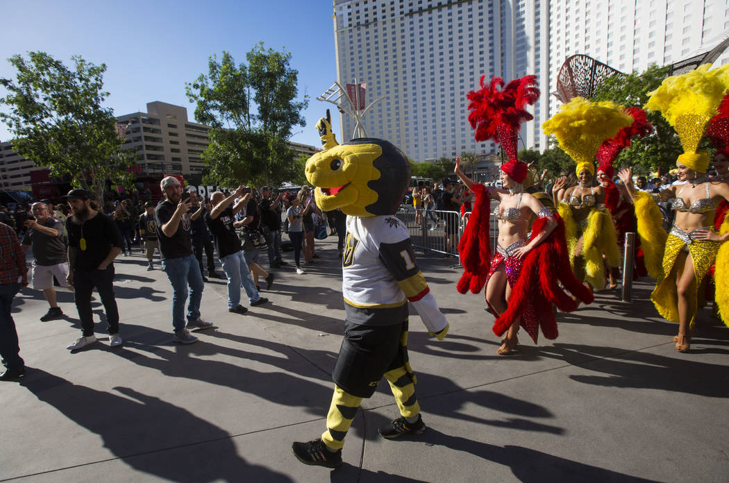 Golden Knights mascot Chance leads a pregame parade ahead of Game 3 of the NHL Western Conference finals hockey playoff series at T-Mobile Arena in Las Vegas on Wednesday, May 16, 2018. Chase Stev ...
