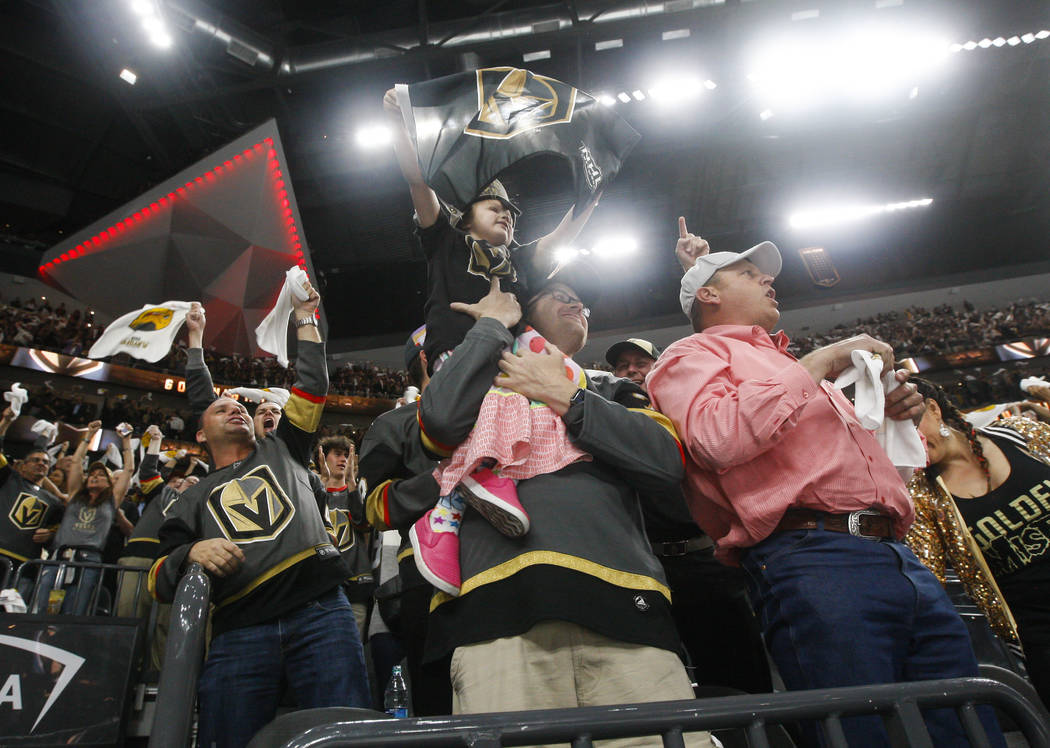 Golden Knights fans celebrate a goal by Golden Knights center Jonathan Marchessault, not pictured, during the first period of Game 3 of the NHL Western Conference finals hockey playoff series agai ...