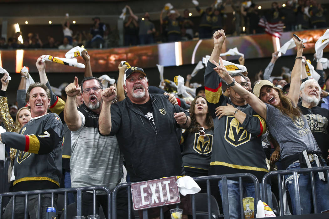 Golden Knights fans celebrate a goal by James Neal, not pictured, during the second period of Game 3 of the NHL Western Conference finals hockey playoff series against the Winnipeg Jets at T-Mobil ...