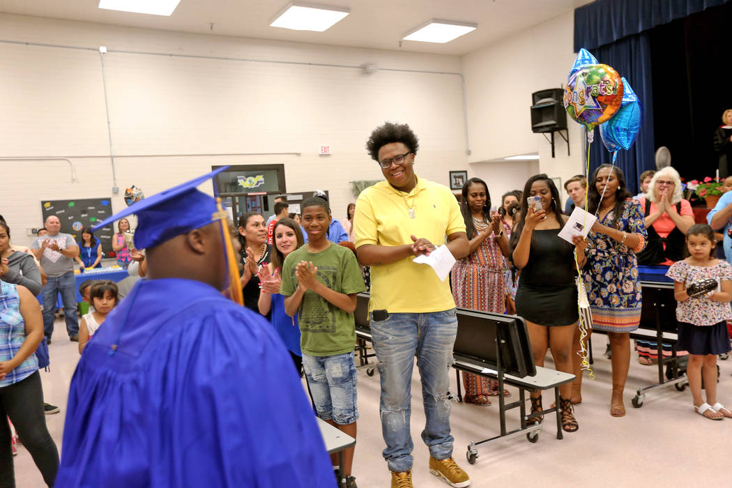 The crowd applauds Tobby Davis as he makes his way to the front at Helen J. Stewart School in Las Vegas, Wednesday, May 16, 2018. The special needs school hosted a graduation ceremony for students ...