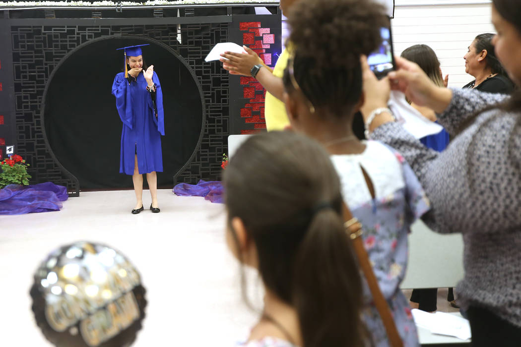 The crowd applauds Natalia Martinez before she makes her way to the front at Helen J. Stewart School in Las Vegas, Wednesday, May 16, 2018. The special needs school hosted a graduation ceremony fo ...