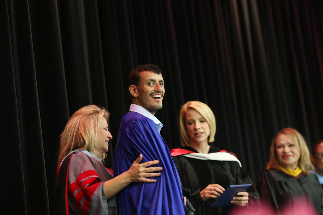 Matthew Khalil smiles while receiving his diploma during a graduation ceremony at Helen J. Stewart School, a special needs school, in Las Vegas, Wednesday, May 16, 2018. Rachel Aston Las Vegas Rev ...