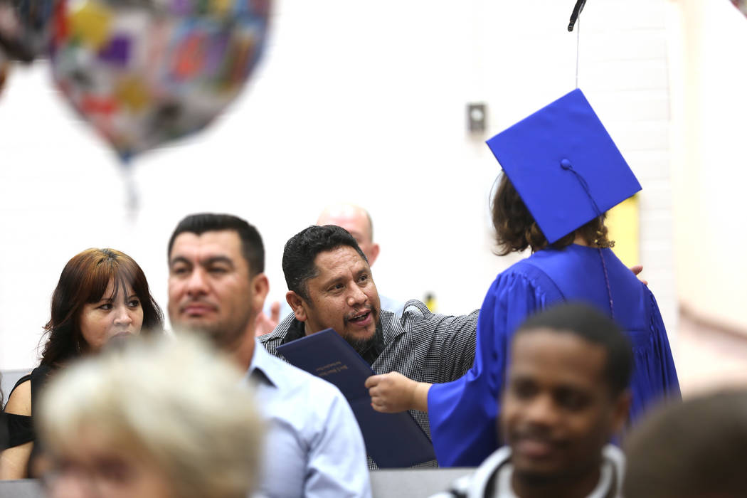 Mario Rodriguez congratulates his daughter Brenda Rodriguez after she received her diploma during a graduation ceremony at Helen J. Stewart School, a special needs school, in Las Vegas, Wednesday, ...
