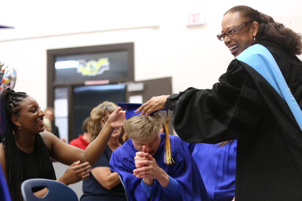 Dr. Linda Young changes the tassel of Christopher Ruesch during a graduation ceremony at Helen J. Stewart School, a special needs school, in Las Vegas, Wednesday, May 16, 2018. Rachel Aston Las Ve ...