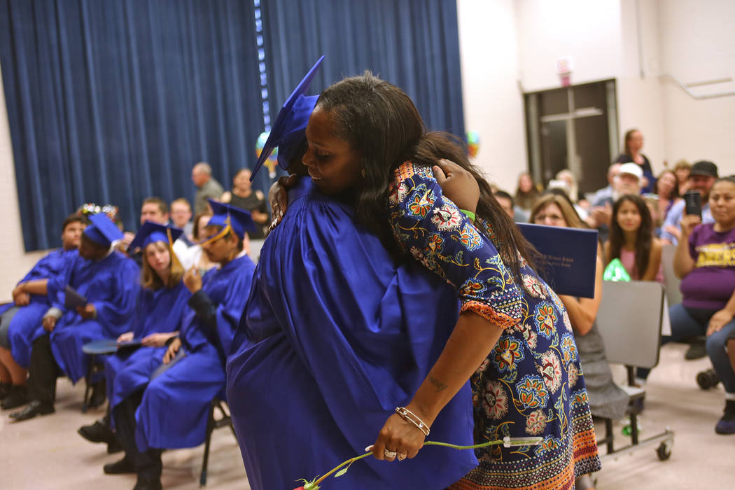 Tobby Davis hugs his mom Pamela Gultry during a graduation ceremony at Helen J. Stewart School, a special needs school, in Las Vegas, Wednesday, May 16, 2018. Rachel Aston Las Vegas Review-Journal ...