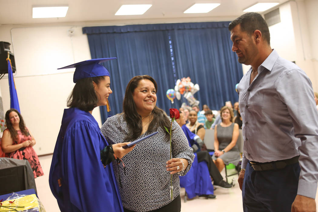 Maria Navarrete and Jesus Martinez congratulate their daughter Natalia Martinez during a graduation ceremony at Helen J. Stewart School, a special needs school, in Las Vegas, Wednesday, May 16, 20 ...