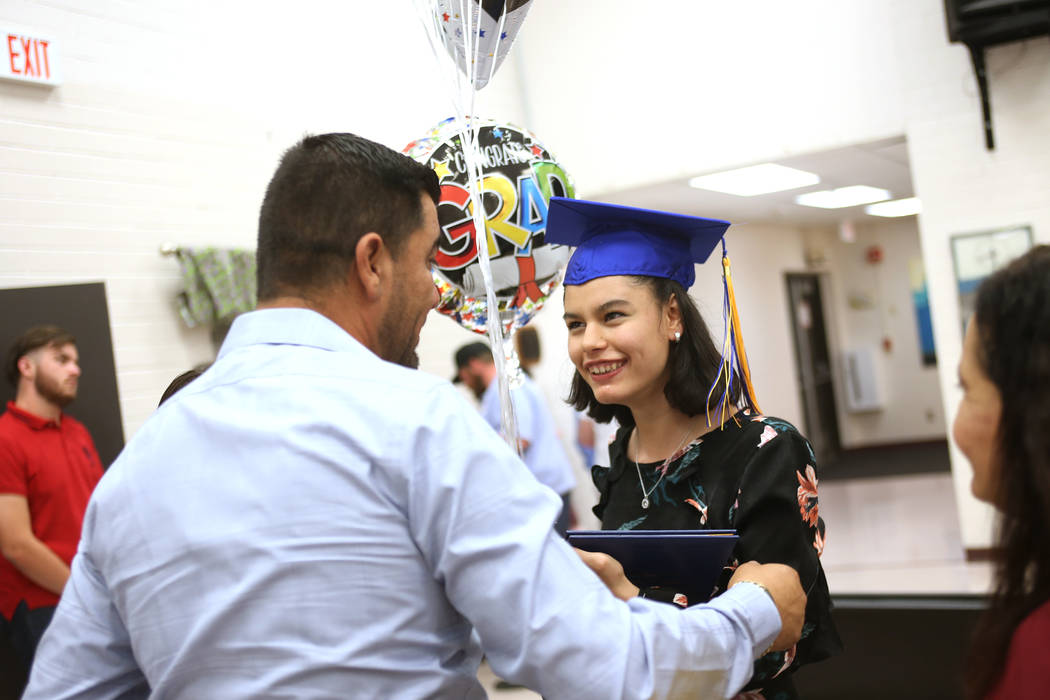 Jesus Martinez congratulates his daughter Natalia Martinez during a graduation ceremony at Helen J. Stewart School, a special needs school, in Las Vegas, Wednesday, May 16, 2018. Rachel Aston Las ...