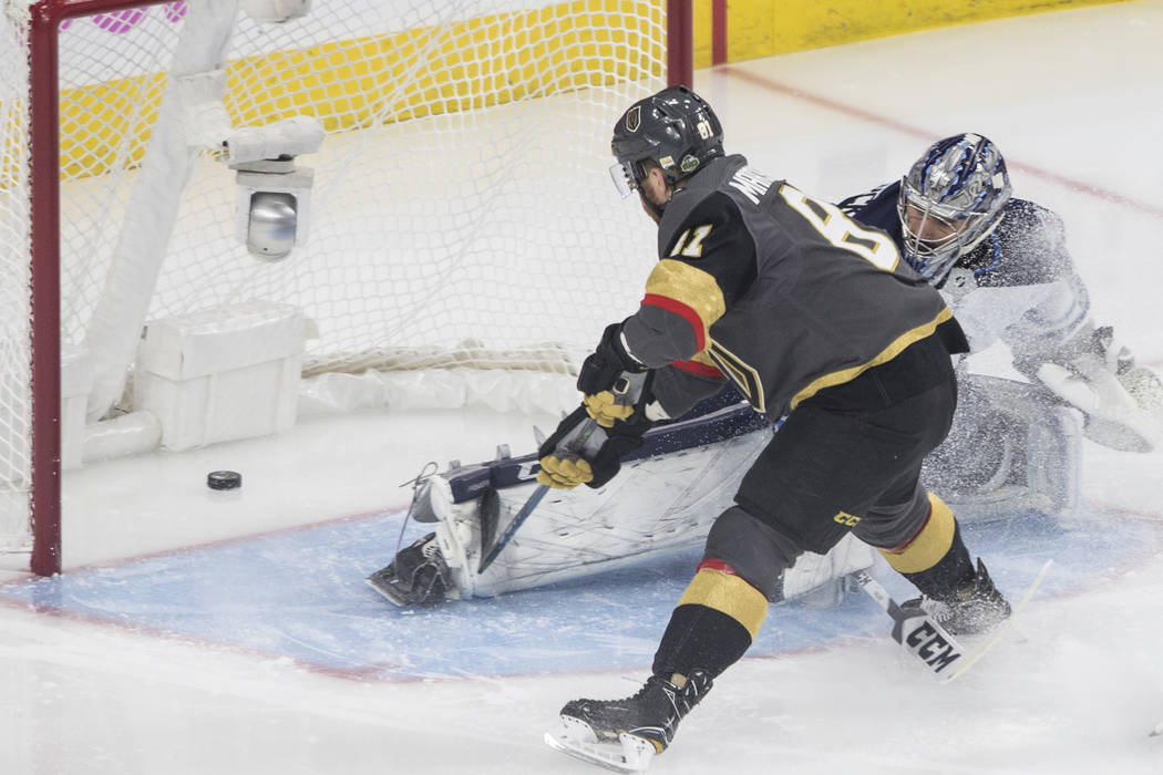 Golden Knights center Jonathan Marchessault (81) scores a first period goal past Jets goaltender Connor Hellebuyckus (37) during game three of Las Vegas' NHL Western Conference Finals matchup with ...
