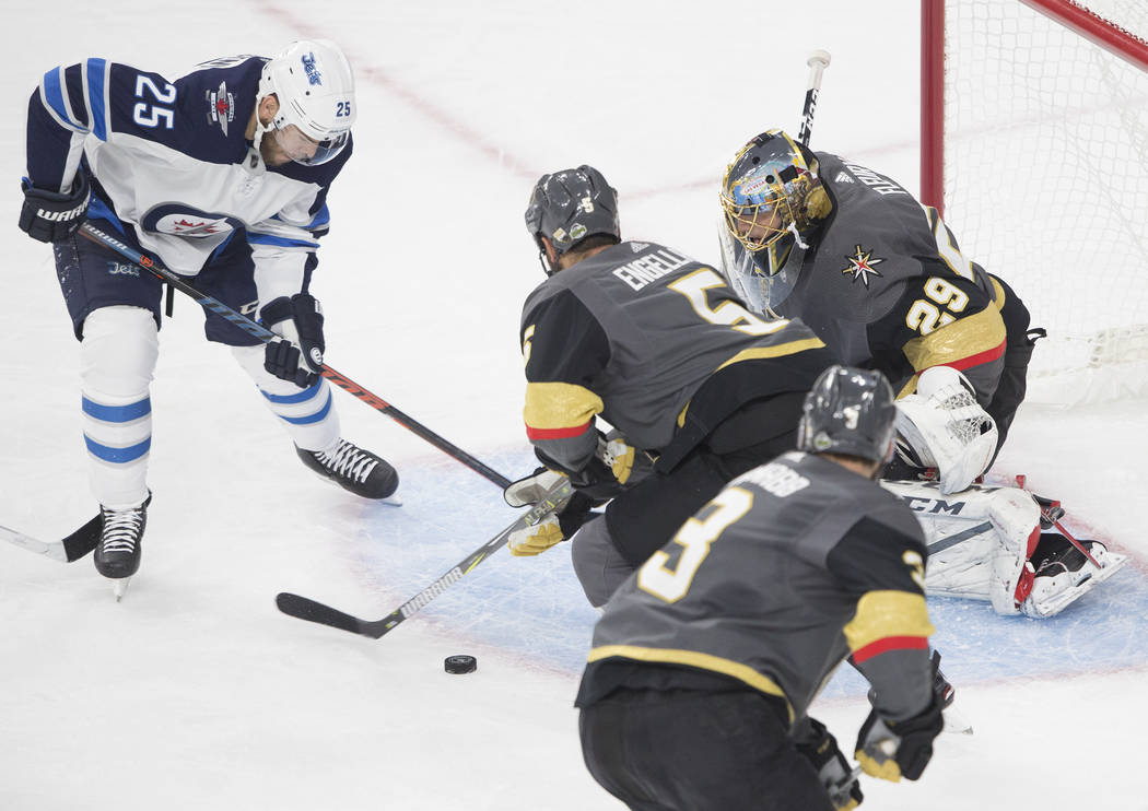 Golden Knights goaltender Marc-Andre Fleury (29) makes a save against Jets center Paul Stastny (25) in the first period during game three of Las Vegas' NHL Western Conference Finals matchup with W ...