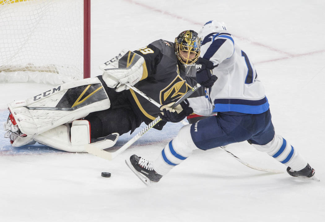 Golden Knights goaltender Marc-Andre Fleury (29) makes a save against Jets left wing Shawn Matthias (16) in the second period during game three of Las Vegas' NHL Western Conference Finals matchup ...