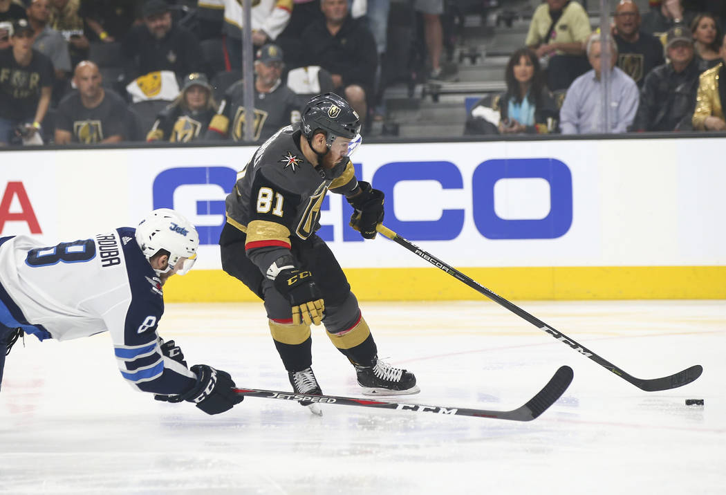 Golden Knights center Jonathan Marchessault (81) gets past Winnipeg Jets defenseman Jacob Trouba (8) before scoring against Winnipeg Jets goaltender Connor Hellebuyck, not pictured, during the fir ...