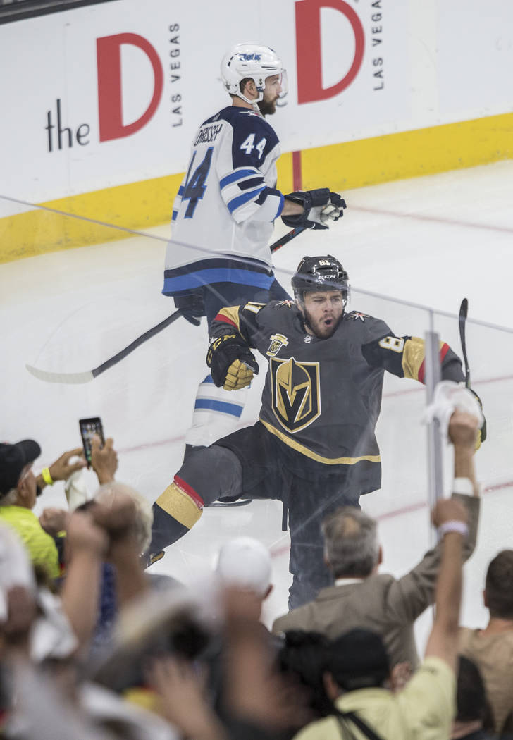 Golden Knights center Jonathan Marchessault (81) celebrates after scoring a first period goal past Jets goaltender Connor Hellebuyck during game three of Las Vegas' NHL Western Conference Finals ...