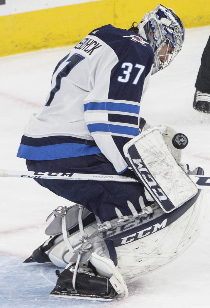 Jets goaltender Connor Hellebuyck (37) makes a save in the first period during game three of Winnipeg's NHL Western Conference Finals matchup with Las Vegas on Wednesday, May 16, 2018, at T-Mobile ...