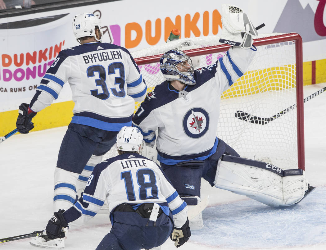 Jets goaltender Connor Hellebuyck (37) makes a save in the first period during game three of Winnipeg's NHL Western Conference Finals matchup with Las Vegas on Wednesday, May 16, 2018, at T-Mobil ...