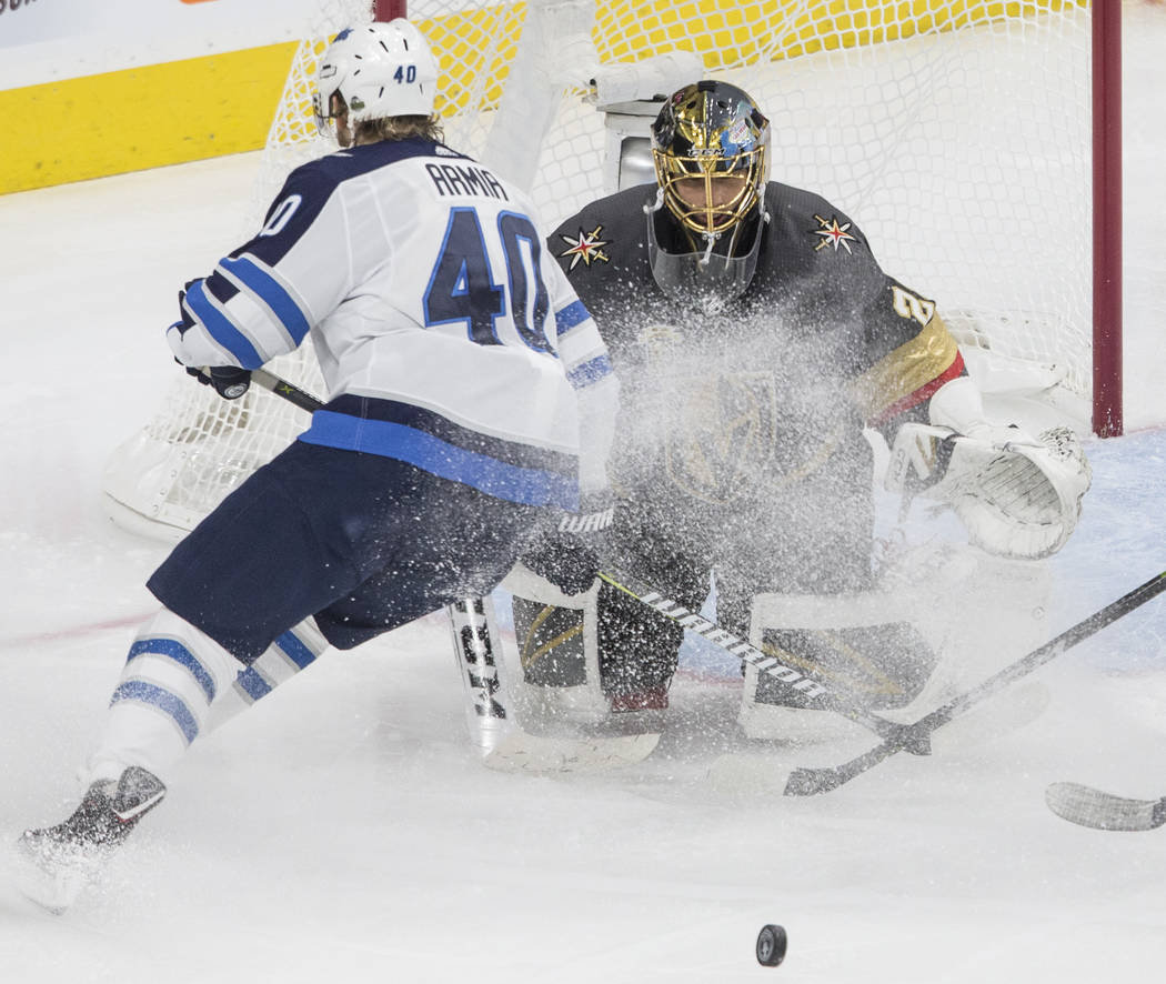 Golden Knights goaltender Marc-Andre Fleury (29) makes a save against Jets right wing Joel Armia (40) in the second period during game three of Las Vegas' NHL Western Conference Finals matchup wit ...