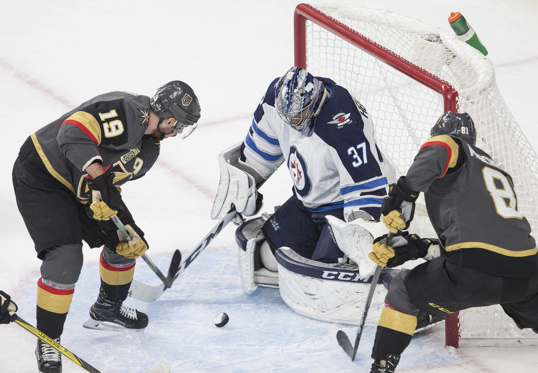 Golden Knights right wing Reilly Smith (19) shoots on Jets goaltender Connor Hellebuyckus (37) in the second period during game three of Las Vegas' NHL Western Conference Finals matchup with Winni ...