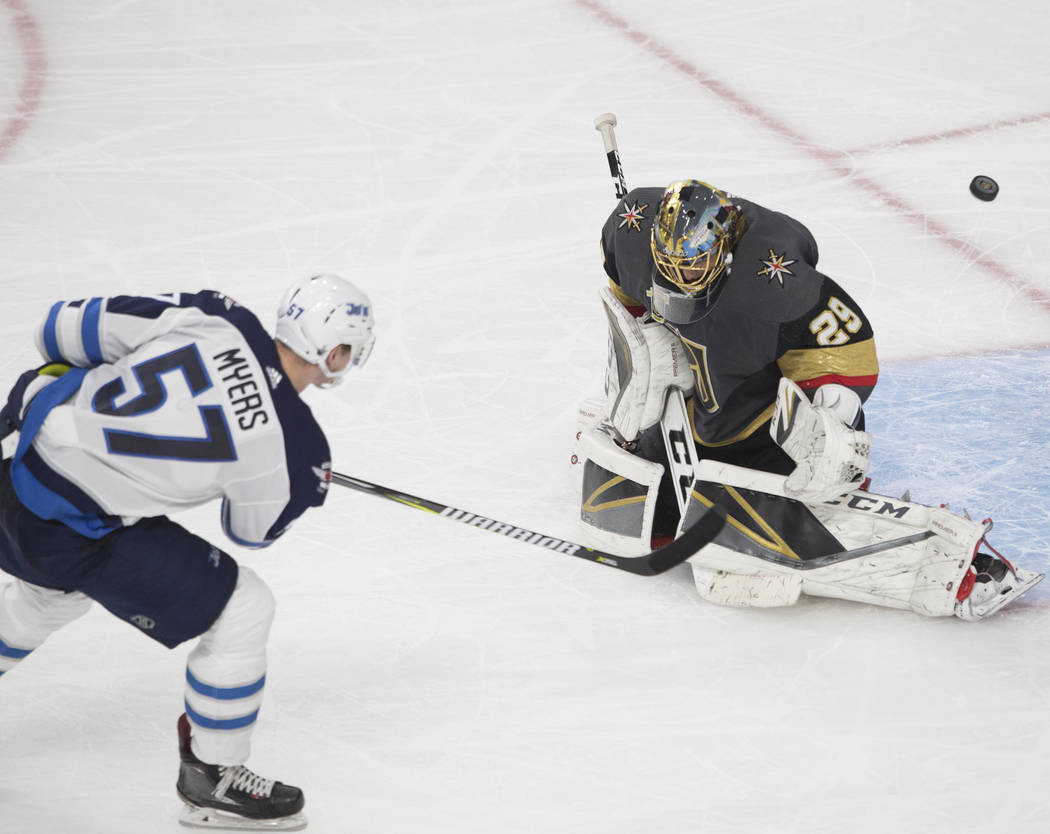 Golden Knights goaltender Marc-Andre Fleury (29) makes a save against Jets defenseman Tyler Myers (57) in the third period during game three of Las Vegas' NHL Western Conference Finals matchup wi ...