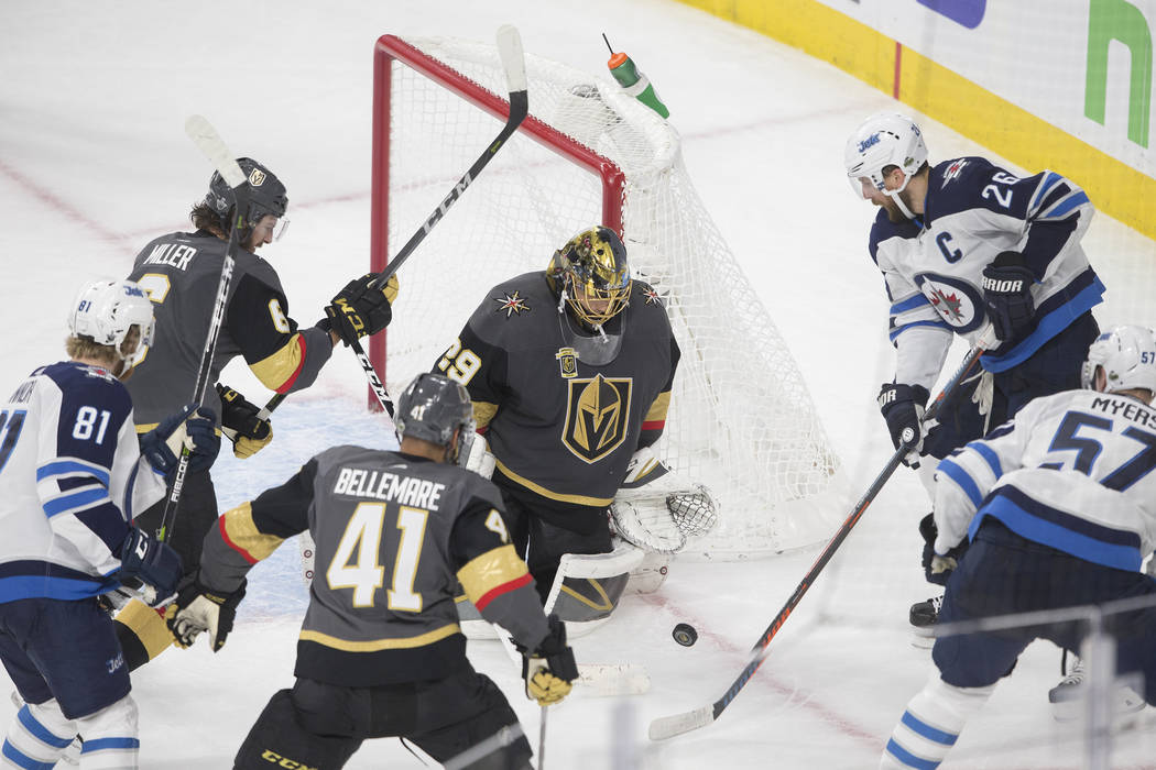 Golden Knights goaltender Marc-Andre Fleury (29) makes a save in traffic in the third period during game three of Las Vegas' NHL Western Conference Finals matchup with Winnipeg on Wednesday, May 1 ...