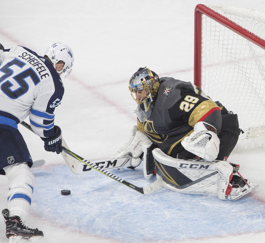 Golden Knights goaltender Marc-Andre Fleury (29) makes a save against Jets center Mark Scheifele (55) in the third period during game three of Las Vegas' NHL Western Conference Finals matchup w ...