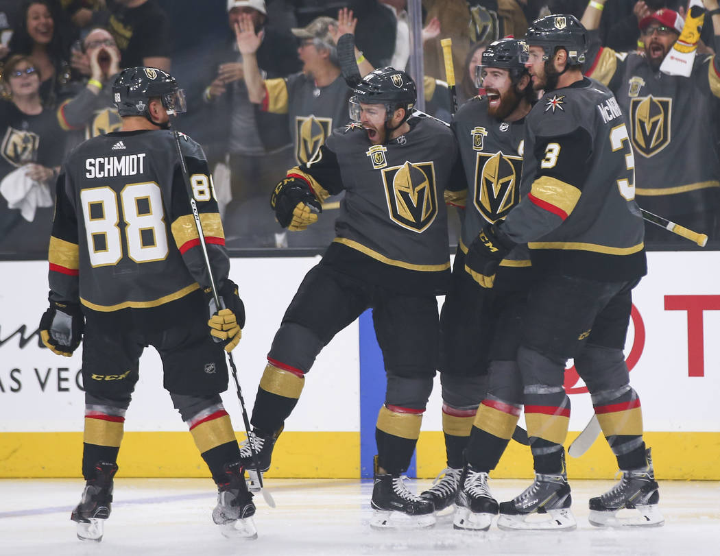 Golden Knights center Jonathan Marchessault, second from left, celebrates his goal with teammates, from left, Nate Schmidt (88), James Neal (18) and Brayden McNabb (3) during the first period of G ...