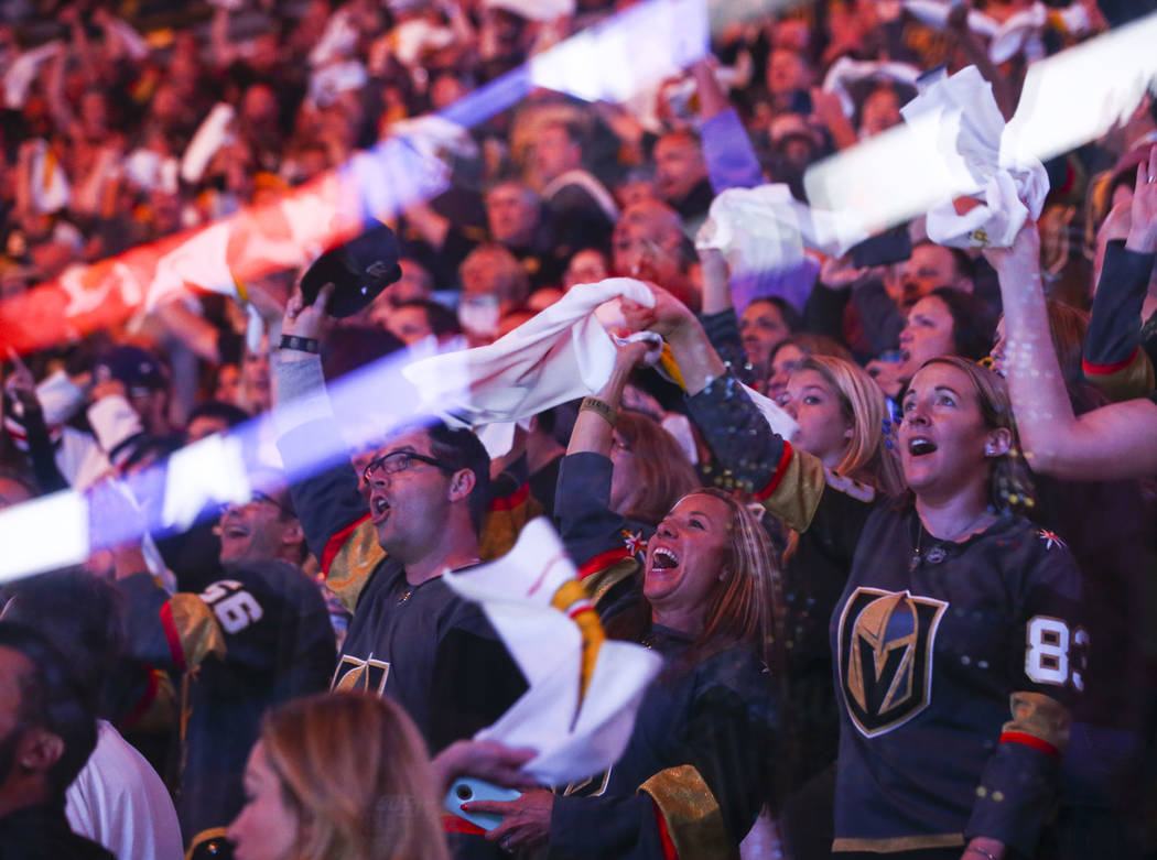 Golden Knights fans cheer while watching a flyover before the start of Game 3 of the NHL Western Conference finals hockey playoff series at T-Mobile Arena in Las Vegas on Wednesday, May 16, 2018. ...