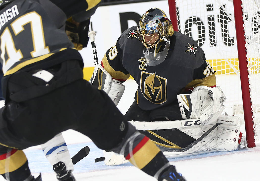 Golden Knights goaltender Marc-Andre Fleury (29) blocks a shot from Winnipeg Jets left wing Brandon Tanev, not pictured, during the second period of Game 3 of the NHL Western Conference finals hoc ...