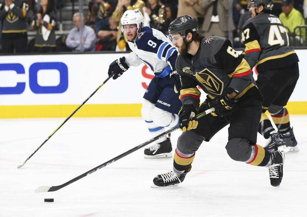 Golden Knights defenseman Colin Miller (6) moves the puck past Winnipeg Jets center Andrew Copp (9) during the second period of Game 3 of the NHL Western Conference finals hockey playoff series at ...
