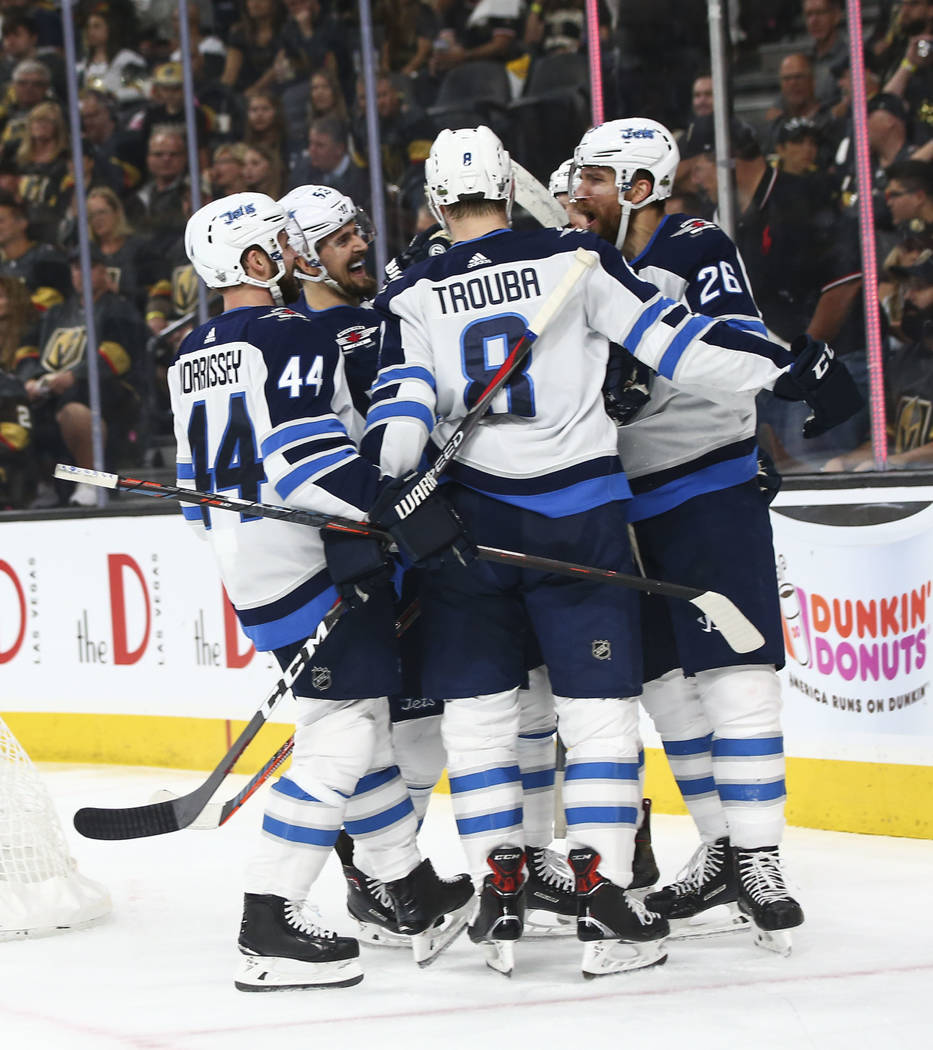 Winnipeg Jets players celebrate a goal against the Golden Knights during the second period of Game 3 of the NHL Western Conference finals hockey playoff series at T-Mobile Arena in Las Vegas on We ...