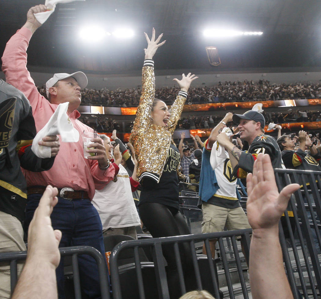 Golden Knights fans celebrate a goal by Alex Tuch, not pictured, during the second period of Game 3 of the NHL Western Conference finals hockey playoff series at T-Mobile Arena in Las Vegas on Wed ...